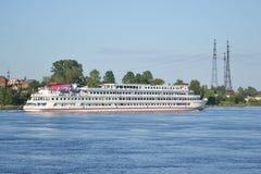 River cruise ship sailing on the river Neva. ST.PETERSBURG, RUSSIA - JULY 21, 2014: River cruise ship sailing on the river Neva, outskirts of St. Petersburg Stock Photo