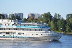 River cruise ship sailing on the river Neva. ST.PETERSBURG, RUSSIA - JULY 20, 2014: River cruise ship sailing on the river Neva, outskirts of St. Petersburg Stock Photo