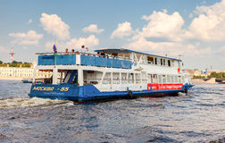River cruise ship sailing on the river Neva in summer sunny day. SAINT PETERSBURG, RUSSIA - AUGUST 7, 2014: River cruise ship sailing on the river Neva in summer Stock Photo