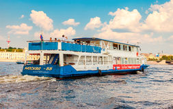 River cruise ship sailing on the river Neva in summer sunny day. SAINT PETERSBURG, RUSSIA - AUGUST 7, 2014: River cruise ship sailing on the river Neva in summer Stock Photography