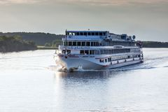 River cruise ship on the Volga river. TVER REGION, RUSSIA - SEPTEMBER 10, 2017:  River cruise ship on the Volga river in the evening Royalty Free Stock Image