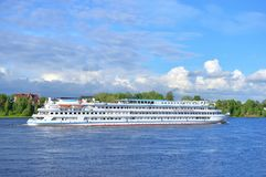 River cruise ships on Neva River. River cruise ships on Neva River at sunny day the outskirts of St.Petersburg, Russia Royalty Free Stock Image