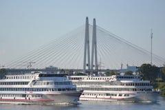 River cruise ships sailing on the river Neva Stock Photos