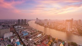 River curved over Bangkok city downtown skyline with after sunset sky. Background, Thailand stock photography
