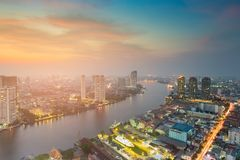 River curved over city downtown with sunset background. Cityscape background Royalty Free Stock Photography