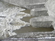 River Dam. In winter time with heavy flowing water Stock Photos