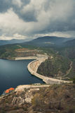 River And Dam Surrounded By Mountains View Royalty Free Stock Photos