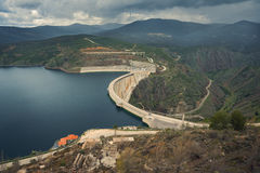 River And Dam Surrounded By Mountains View Royalty Free Stock Photography