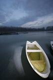 River Danube. Old boat on frozen river Danube in january stock photography