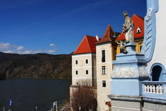 River Danube and houses in Austria, Europe. The famous blue towered Durnstein monastery with houses of the village and with the river Danube in the Wachau-region Stock Photography