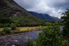 River. Dark clouds over Ben Nevis range Royalty Free Stock Photos