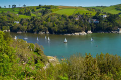 The River Dart near Dartmouth and the Devon coast. Yachts sailing on the River Dart near Dartmouth and the Devon coastline.  This is the mouth of the Dart Stock Image