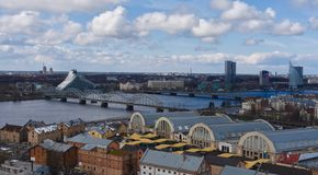 River Daugava. View over river Daugava showing rail bridge, national library and central market in Riga, capital of Latvia royalty free stock images
