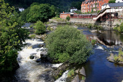 River Dee Llangollen. Llangollen  is a small town in Denbighshire, north-east Wales, situated on the River Dee and on the edge of the Berwyn mountains Royalty Free Stock Images