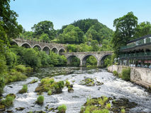 River Dee in Llangollen Wales UK. River Dee with road and railway bridges in Llangollen Denbighshire Wales UK Royalty Free Stock Images