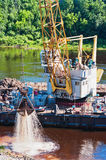 River  deepening by a special dredge. Mounted on the barge Stock Photo