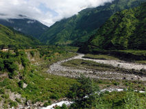 River Delta in Green Lower Himalayas. A river delta in the green lower Annapurna Himalayas of Nepal during monsoon Stock Photos