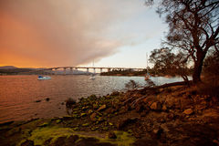 River Derwent Hobart. Fiery sunset on the River Derwent in Hobart, Tasmania, with Mount Wellington in background Royalty Free Stock Images