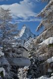 Snow covered landscape at the foot of the Matterhorn, a stream t Stock Photo