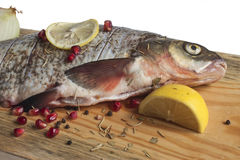 River disemboweled fish with seasonings. On a board Stock Photos