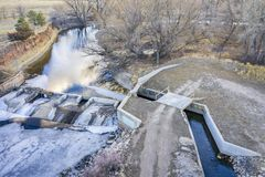 River diversion dam from above. A diversion dam on the Cache la Poudre River in northern Colorado - aerial view with late fall or winter scenery royalty free stock photography