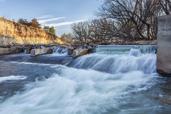 River diversion dam in Colorado. River dam diverting water for farmland irrigation, Cache la Poudre RIver in Fort Collins, Colorado, winter or early spring Royalty Free Stock Photos