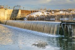 River diversion dam in northern Colorado. River diversion dam on St Vrain Creek in northern Colorado near Platteville, winter scenery Stock Images