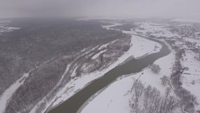 The river divides a small town and forest, the winter season stock video footage