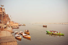 River dock area with riverboats at evening on sacred river Ganges Stock Photo