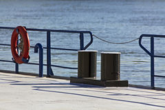 River dock. Red  buoy  lifesaving ring at  river  dock Stock Images