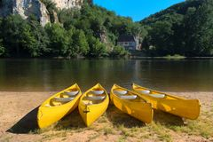 River the Dordogne with canoes for rent Stock Photos