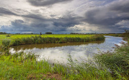 River with Dramatic Clouds In Friesland, Netherlands Royalty Free Stock Image