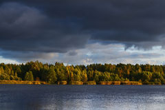 River and the dramatic cloudscape after the rain in Latvia Stock Photo