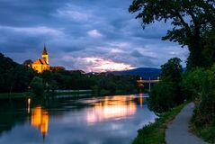 The river Drava in the evening at sunset. Koroska Bridge and Church of St. Joseph in the background. Maribor, Slovenia, Europe