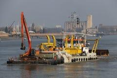 River Dredging. Dredging barge busy on the river Schelde in Antwerp Belgium Stock Images