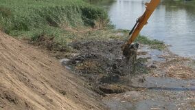 River Dredging Machinery Lifts Sand and Mud with Giant Shovel from River Bottom