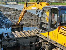 River dredging with tracked excavator Royalty Free Stock Photos