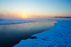 The river and drift ice sunrise Royalty Free Stock Photography