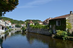 River Dronne passing through the village of Brantôme, France. River Dronne passing through the village of Brantôme, France. Sunny day in summer Royalty Free Stock Photo
