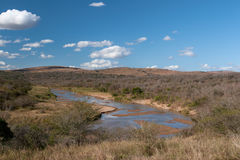 River in dry season. African landscape in the Hluhluwe National Park, South Africa Stock Photo