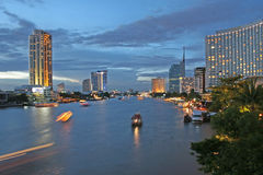 River at Dusk. Boats on the Chao Praya River in Bangkok at dusk Stock Images