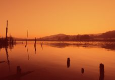 River dyed red. Sunset on the banks of the river Nile, Egypt Stock Photo