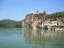 River Ebro as it passes through the town of Miravet, Tarragona stock photography