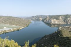 The river Ebro. On its way through Mequinenza, Aragon stock image