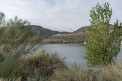The river Ebro. On its way through Mequinenza, Aragon royalty free stock image