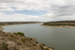 The river Ebro. On its way through Caspe, Aragon stock images