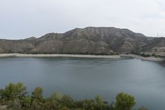 The river Ebro. On its way through Mequinenza, Aragon stock photography