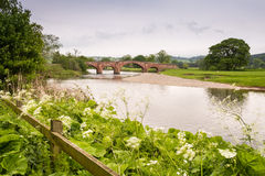 River Eden. The Eden road bridge near Lazenby is 18th century built from local red sandstone Royalty Free Stock Images