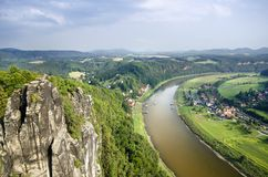 The River Elbe at Rathen. View of the River Elbe and the Mountains of the Swiss Saxony at the touristic village of Rathen Stock Photography
