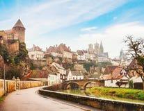 River embankment Armancon, Semur-en-Auxois, Burgundy, France. Toned image Stock Photos